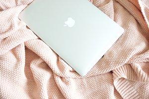 Laptop on Pink Blanket