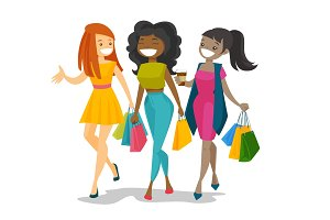 Young happy multicultural women shopping together.