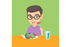 Little caucasian boy eating vegetable salad.