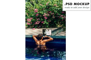 Laptop PSD mockup at the pool