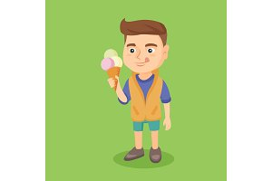 Little caucasian boy holding an ice cream cone.
