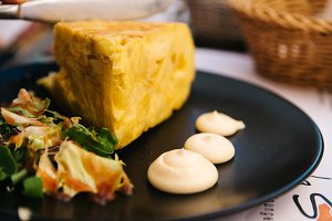 Spanish omelette with mayonnaise in restaurant