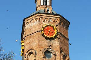 Old building tower with red clock
