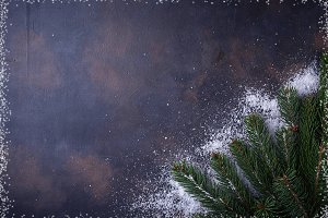 Fir tree branches with snowflakes.