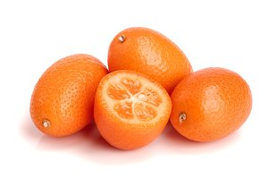 Cumquat or kumquat with half isolated on white background close up