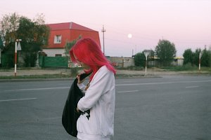 Girl with pink hair and a full moon