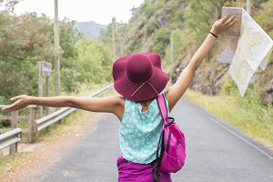 girl enjoying outdoors with arms aloft