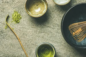 Japanese tools for brewing matcha tea, grey concrete background