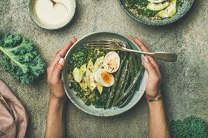Quinoa, kale, green beans, avocado, egg bowls flat-lay