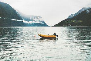 Yellow boat in sea fjord