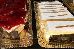 Pastry cakes in trays