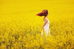 beautiful girl in the yellow field