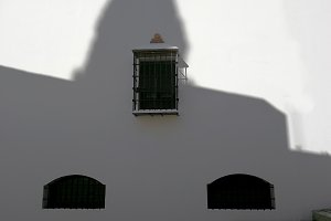 Contrast of shadows on white facade