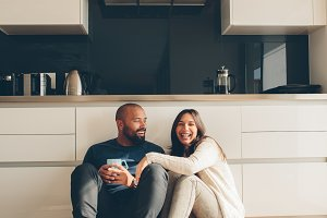 Couple sitting on kitchen floor