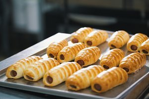 Sausages in dough in a tray