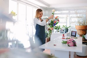 Female florist creating order