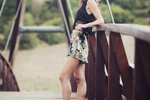 smiling girl on a bridge