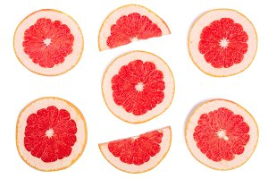 Grapefruit slices isolated on white background. Top view. Flat lay pattern
