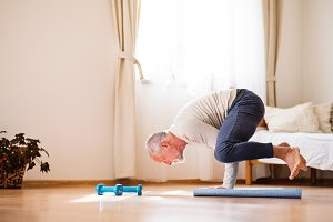 Senior man doing exercise at home.