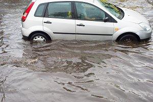 crossing flooded urban road