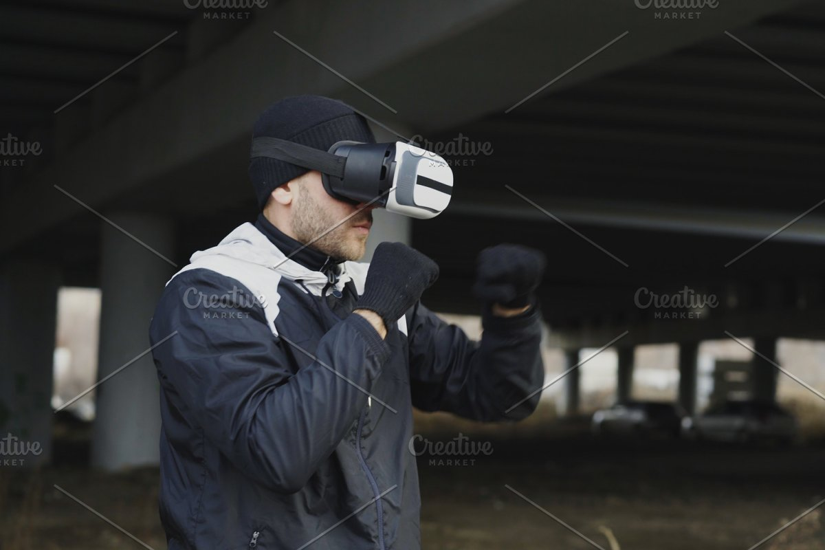 1dd37ea7f529 Martial boxing man in VR 360 headset training punches in virtual ...