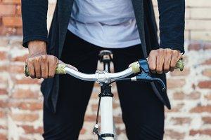 Close up of man riding a bike.