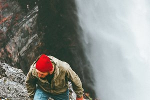 Man hiking waterfall mountains