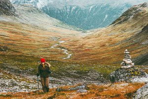 Traveler woman hiking in scandinavia