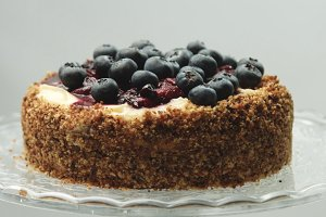 Delicious cake with custard cream and blueberries