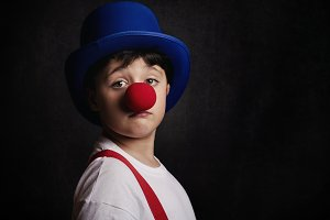 funny boy with clown nose