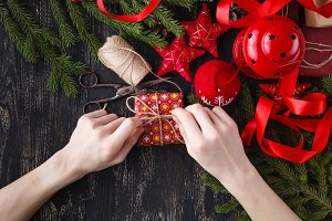 hands wrap christmas holiday gift
