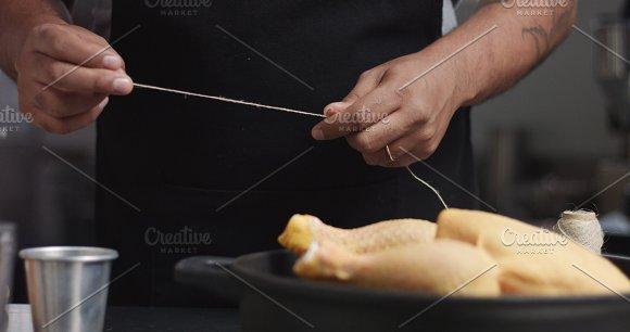 Male Chef Preparing Roast Chicken With Orange And Rosemary