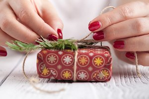 red gift box in female hands