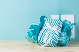 Christmas decorations - colorful presents on blue background