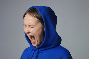 Emotional woman screaming isolated on white