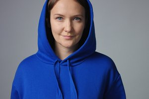 Attractive woman in oversize blue hoodie