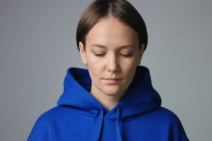 Attractive woman in oversize blue hoodie