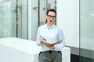 business lady writes in daily log