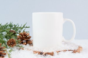 white mug and greenery