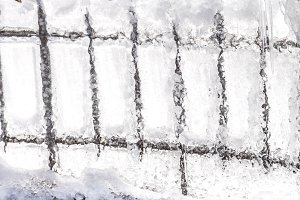 Frozen water on a fence