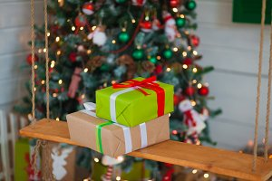 Christmas gifts on the background of trees