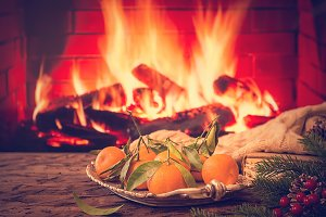 Tray with tangerine in front of fireplace