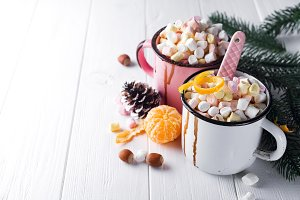 two cups with hot chocolate or cocoa with marshmallow