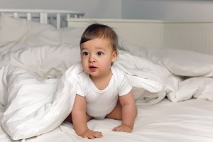 boy baby t-shirt lies under a blanket