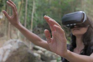 beautiful young brunette woman use virtual reality glasses