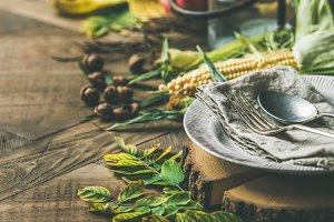 Fall table setting for Thanksgiving day celebration with cutlery, vegetables