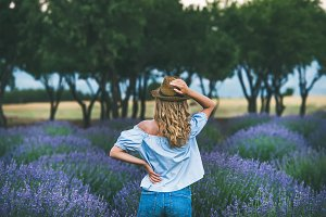 Young woman traveller standing in lavender field, Isparta, Turkey