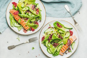 Healthy spring salad with grilled salmon, orange, olives and quinoa