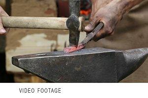 blacksmith forges iron