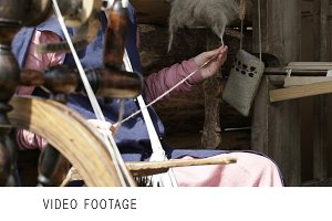 Young female spinning yarn.